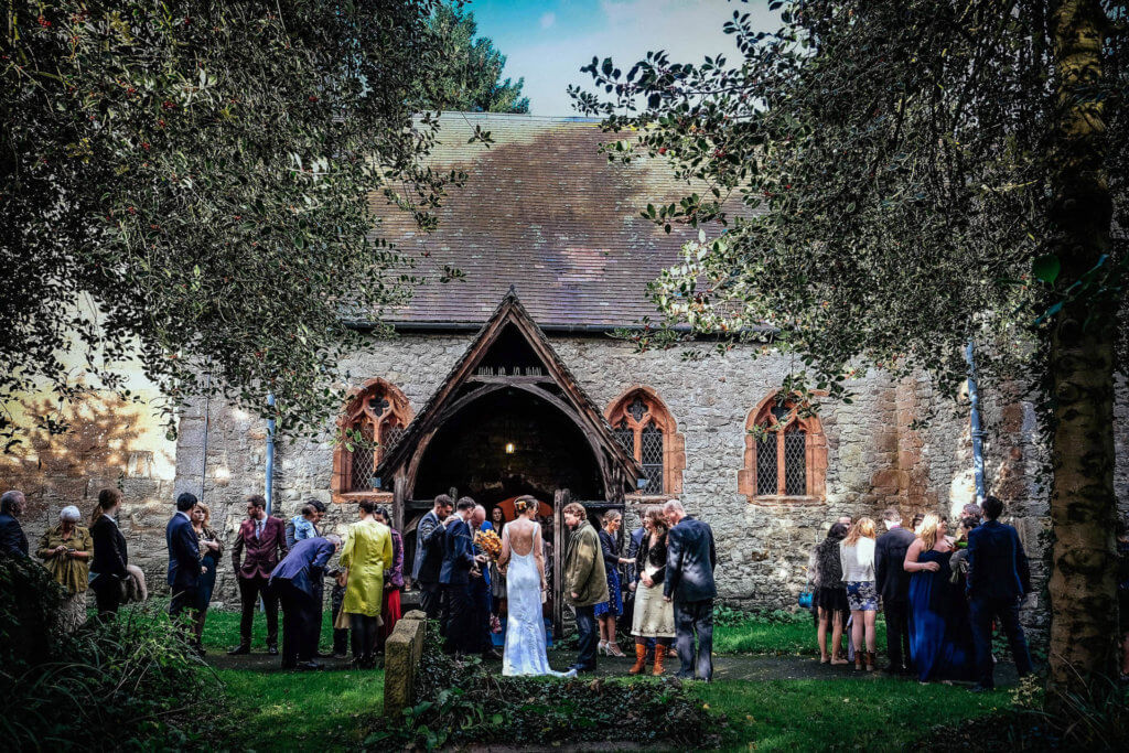 Guests congregating outside the church to congratulate the Bride and Groom