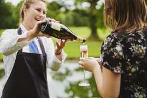 Waitress pours Prosecco for wedding guest